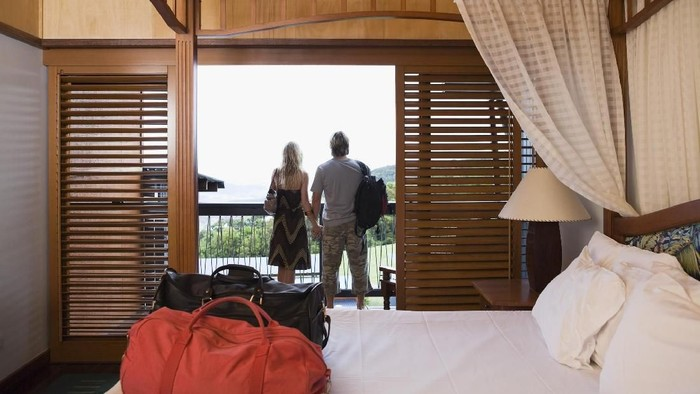 Couple at window in bedroom