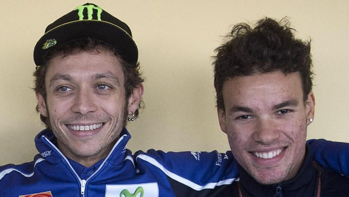 VALENCIA, SPAIN - NOVEMBER 08:  (L-R) Niccolo Antonelli of Italy and Junior Team Go&Fun Moto3, Valentino Rossi of Italy and Movistar Yamaha MotoGP and Franco Morbidelli of Italy and Italtrans Racing Team pose during the press conference during the MotoGP of Valencia - Qualifying at Ricardo Tormo Circuit on November 8, 2014 in Valencia, Spain.  (Photo by Mirco Lazzari gp/Getty Images)
