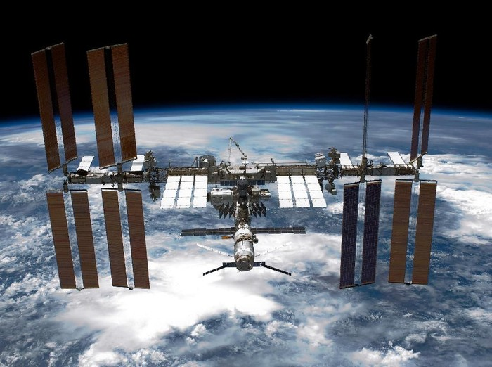 IN SPACE - MAY 29:  In this handout provided by National Aeronautics and Space Administration (NASA), back dropped by planet Earth the International Space Station (ISS) is seen from NASA space shuttle Endeavour after the station and shuttle began their post-undocking relative separation May 29, 2011 in space. After 20 years, 25 missions and more than 115 million miles in space, NASA space shuttle Endeavour is on the last leg of its final flight to the International Space Station before being retired and donated to the California Science Center in Los Angeles. Capt. Mark E. Kelly, U.S. Rep. Gabrielle Giffords (D-AZ) husband, has lead mission STS-134 as it delivered the Express Logistics Carrier-3 (ELC-3) and the Alpha Magnetic Spectrometer (AMS-2) to the International Space Station. (Photo by NASA via Getty Images)