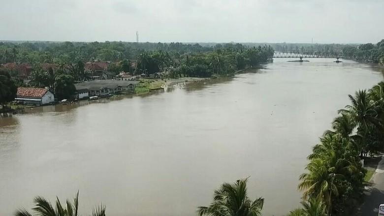 Foto: Penampakan Sungai Ogan yang Meluap Rendam 6 Kecamatan