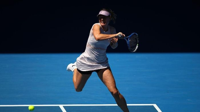 Maria Sharapova menang dua set langsung dan lolos ke babak ketiga Australia Terbuka 2018 (Foto: Cameron Spencer/Getty Images)