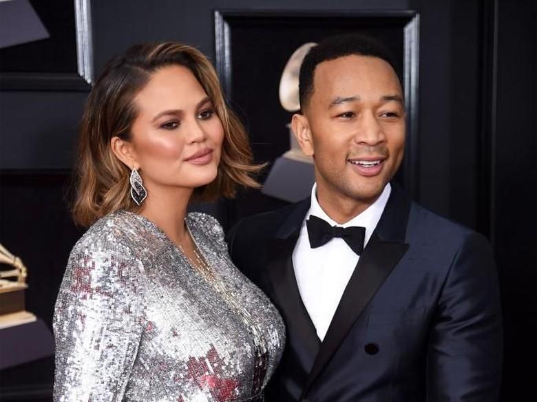 Foto: Chrissy Teigen dan John Legend (Getty Images)