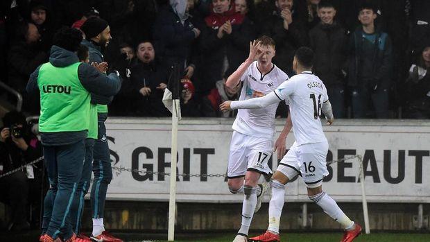 Swansea City berusaha menciptakan keajaiban untuk lolos dari degradasi.