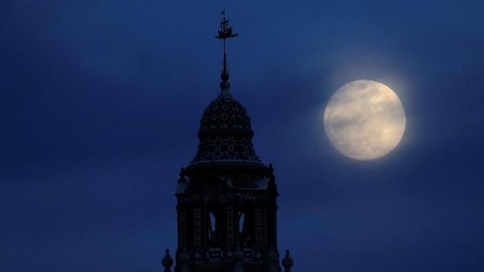 A blue moon rises through clouds in San Diego, California, U.S., January 30, 2018.    REUTERS/Mike Blake