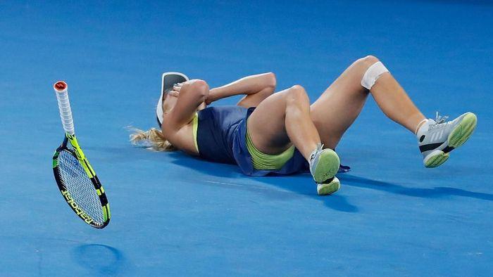 Wozniacki akhirnya berhasil mencicipi gelar juara turnamen tenis grand slam. Dia menjadi juara Australia Terbuka 2018 di Melbourne Park.(Scott Barbour/Getty Images)