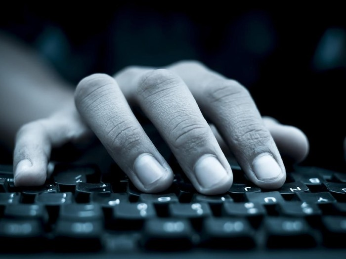 Human hand on keyboard,isolated, selective focus, shallow depth of field, concept of work & technology.