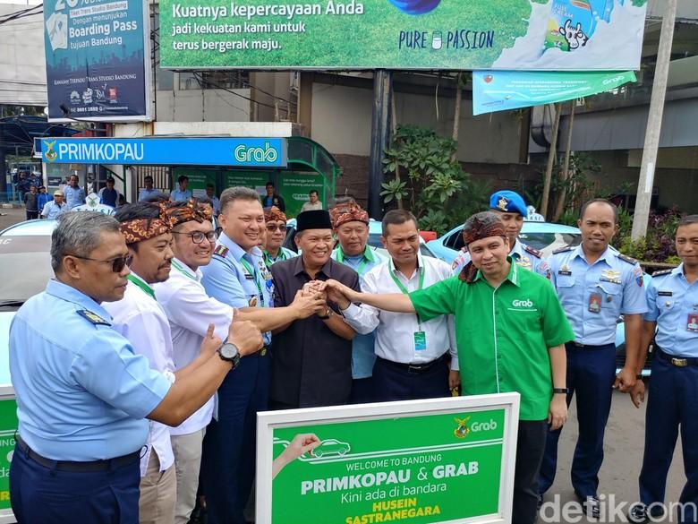 Primkopau Gandeng Grab Sediakan Taksi Online di Bandara Husein