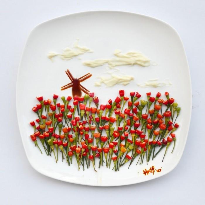 Kebun Tulip bernama Keukenhof ini dibuat dari sisa-sisa bahan makanan. Tulipnya dibuat dari cabai yang bagian atasnya sudah terpotong dengan kincir angin yang terbuat dari saus berwarna cokelat. Waah sangat artistik! Foto: Hong Yi