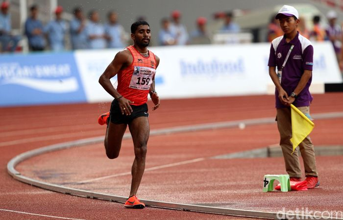 Lakshmanan Govindan berlari agar menjadi yang tercepat.