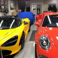 Ada Porsche, McLaren, Ferrari dan Lamborghini nongkrong di garasi rumahnya. Belum koleksi motor sport dan mobil sport lainnya. (Instagram/@ahmadsahroni88)