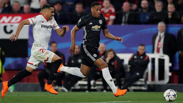 Sevilla ingin menghentikan tren positif Manchester United.