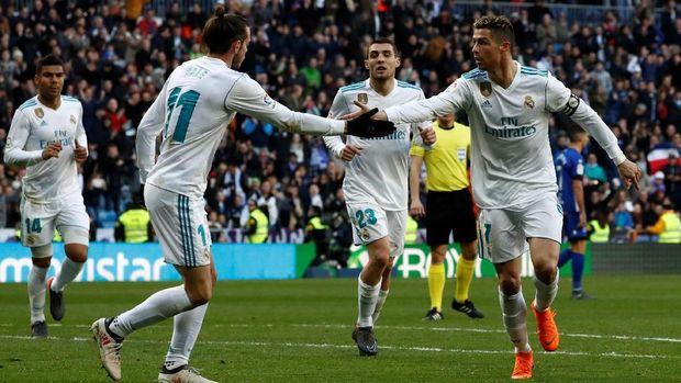 Gareth Bale dan Cristiano Ronaldo mencetak gol untuk Real Madrid. (