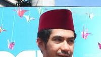 Reza Rahadian saat bersosialisasi dalam film Binyamin: Biang Kerok. Foto: Ismail/detikHOT