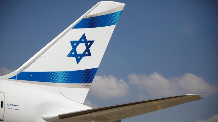 FILE PHOTO: An Israeli flag is seen on the first of Israels El Al Airlines order of 16 Boeing 787 Dreamliner jets, as it lands at Ben Gurion International Airport, near Tel Aviv, Israel August 23, 2017. REUTERS/Amir Cohen/File Photo