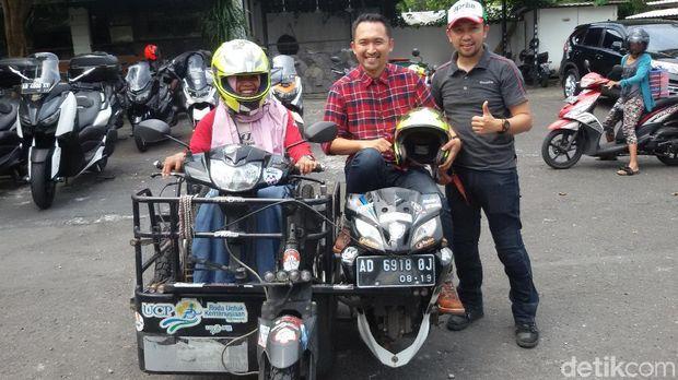 Sri, pemotor difabel yang keliling Indonesia.
