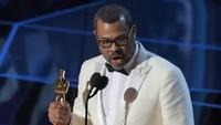 Jordan Peele berhasil membawa pulang piala Best Original Screenplay. REUTERS/Lucas Jackson.