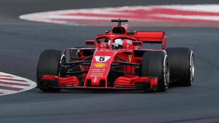 Sebastian Vettel menjadi pebalap tercepat di hari ketiga tes F1 Barcelona (Albert Gea/Reuters)