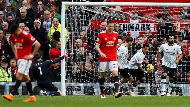 Liverpool berpeluang mencuri kemenangan di markas Manchester United. (