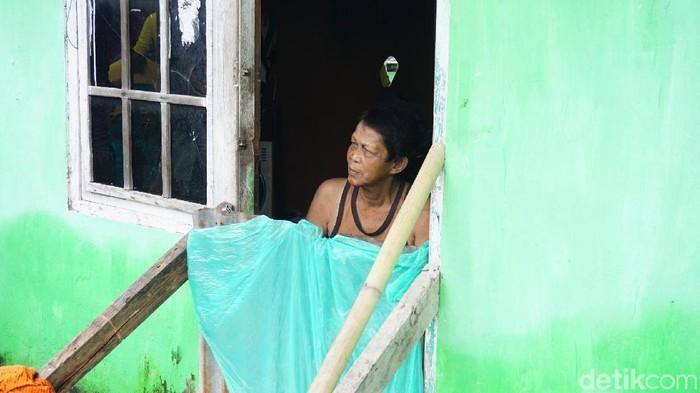 Salah satu suasana kampung kusta di Makassar (Ilustrasi: Suherni)