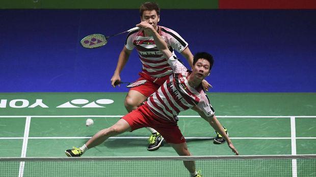 Kevin/Marcus menjadi satu-satunya wakil dari Indonesia yang juara All England 2018. (AFP PHOTO / Paul ELLIS)