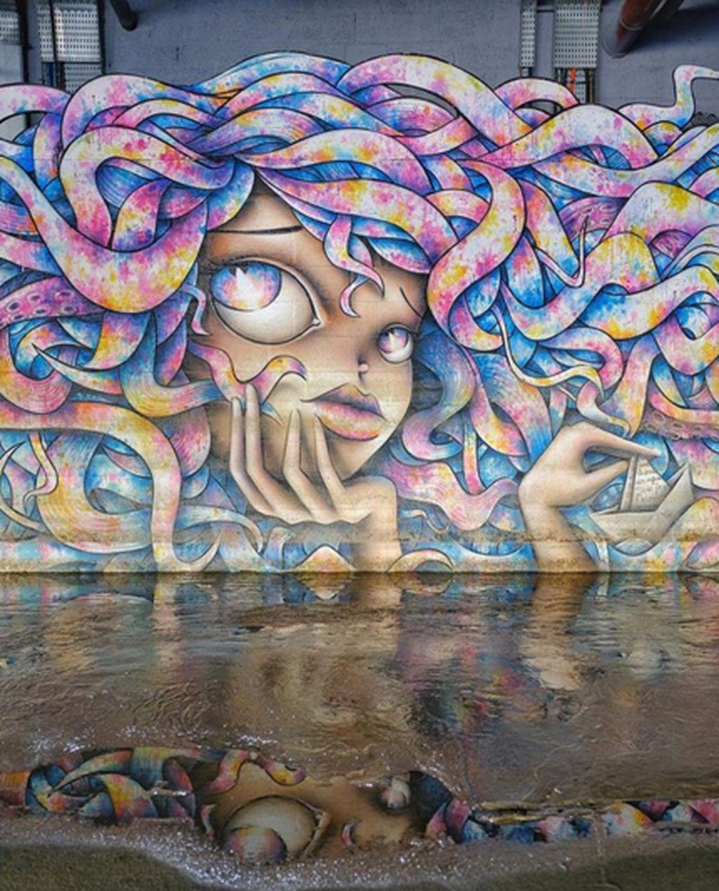Dia adalah Vinie Graffiti seniman jalanan asal Prancis yang membuat lukisan mural dengan skala besar. (Foto: Vinie Graffiti)