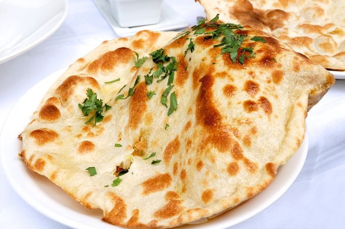 Indian naan bread served on a plate - resubmit with improved lighting