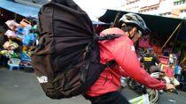 Dilema Kurir Sepeda Menghadapi Polusi Udara Ibu Kota