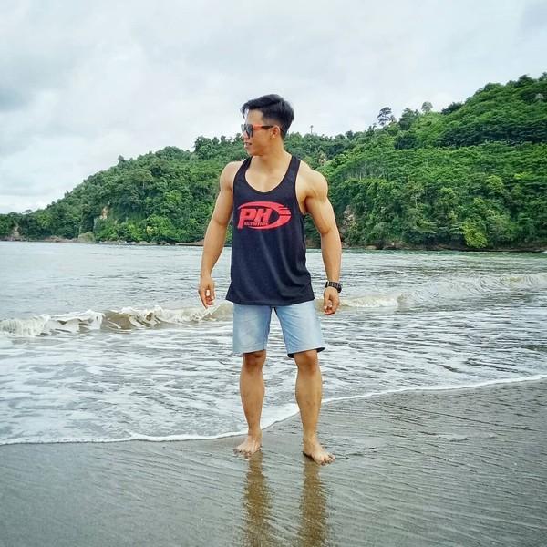 Sepertinya Didi tidak mau melewatkan pesona Pantai Sine yang berada di Tulungagung. Cekrek dulu! (didi_wahyudi89/Instagram)