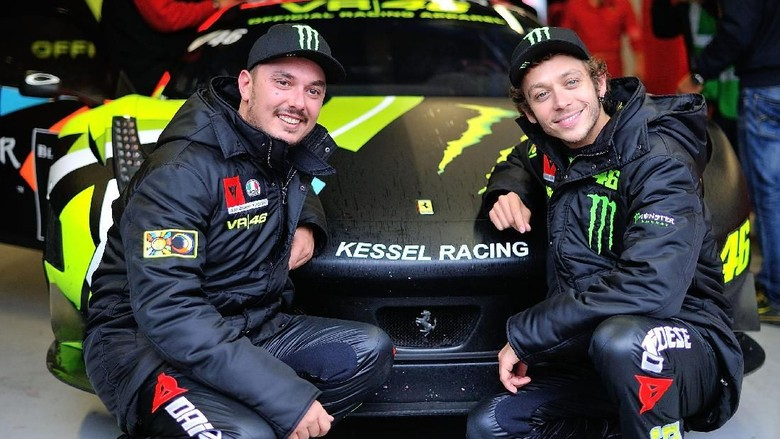MONZA, ITALY - APRIL 13:  Drivers Alessio Uccio Salucci (L) and Valentino Rossi of Team Kessel Racing - Ferrari 458 Italia pose for photographers during the Blancpain GT Endurance test day one at Autodromo di Monza on April 13, 2012 in Monza, Italy.  (Photo by Guido De Bortoli/Getty Images)