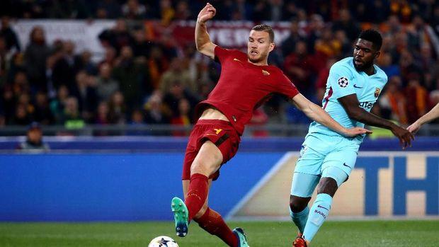 Edin Dzeko membuka keunggulan AS Roma atas Barcelona.