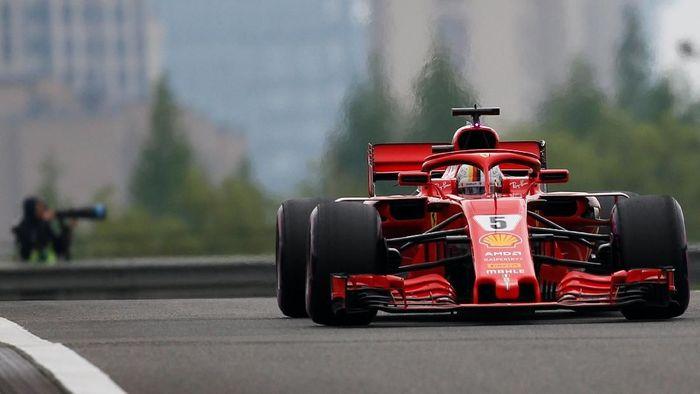 Sebastian Vettel akan start pertama di GP China usai merebut posisi pole dalam kualifikasi (Foto: Aly Song/Reuters)