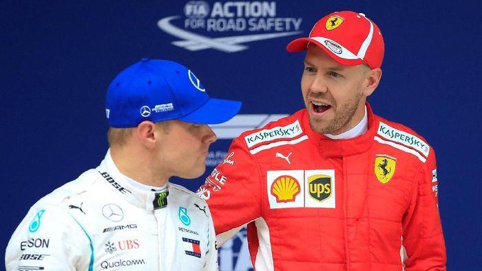 Sebastian Vettel akan start terdepan di GP Shanghai setelah merebut pole dengan selisih waktu mencapai 0,5 detik dari Valtteri Bottas (Foto: Aly Song/Reuters)