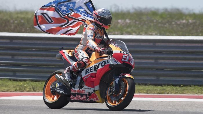 AUSTIN, TX - APRIL 22:  Marc Marquez of Spain and Repsol Honda Team celebrates the MotoGP victory with the flag at the end of the MotoGP race during the MotoGp Red Bull U.S. Grand Prix of The Americas - Race at Circuit of The Americas on April 22, 2018 in Austin, Texas.  (Photo by Getty Images/Getty Images)