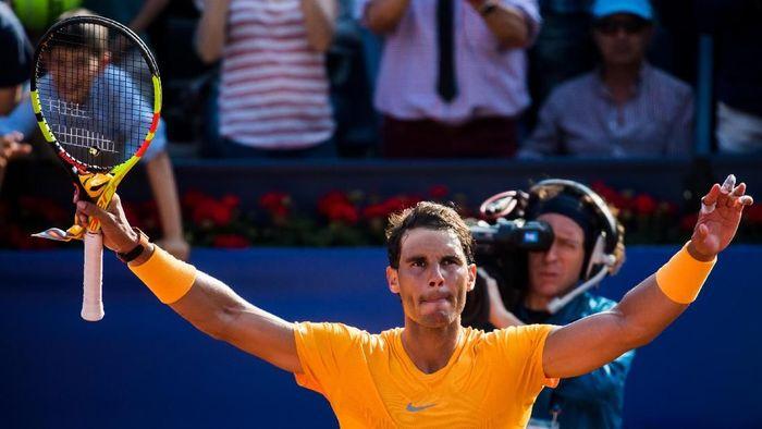 Rafael Nadal lolos ke babak perempatfinal Barcelona Terbuka setelah mengalahkan Guillermo Garcia-Lopez (Foto: Alex Caparros/Getty Images)