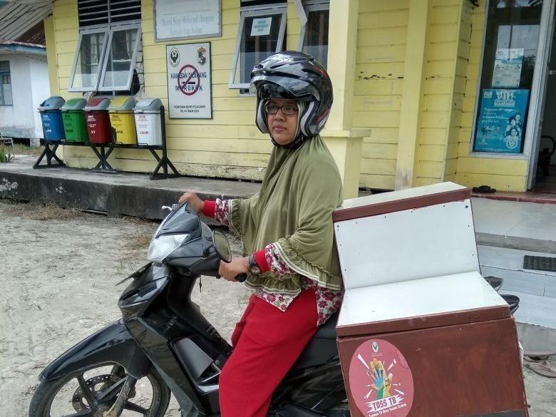 Pakai Sepeda Motor, Sri Susuri Pelosok Riau Cegah Tuberkulosis