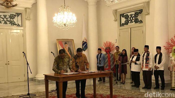 Gubernur DKI Anies Baswedan dan Kepala BKPM Thomas Lembong.Foto: Moch. Zacky/detikcom
