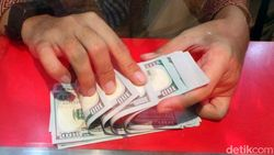 Menguat, Dolar AS Parkir di Level Rp 14.397