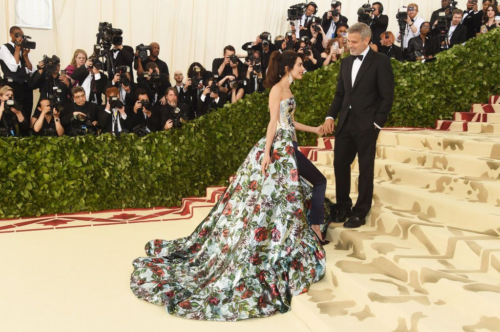 NEW YORK, NY - MAY 07:  Amal Clooney and George Clooney attend the Heavenly Bodies: Fashion & The Catholic Imagination Costume Institute Gala at The Metropolitan Museum of Art on May 7, 2018 in New York City.  (Photo by Jamie McCarthy/Getty Images)