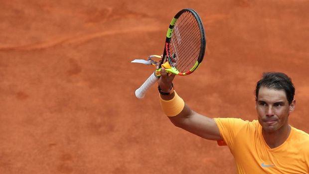 Rafael Nadal lolos ke babak 16 besar.