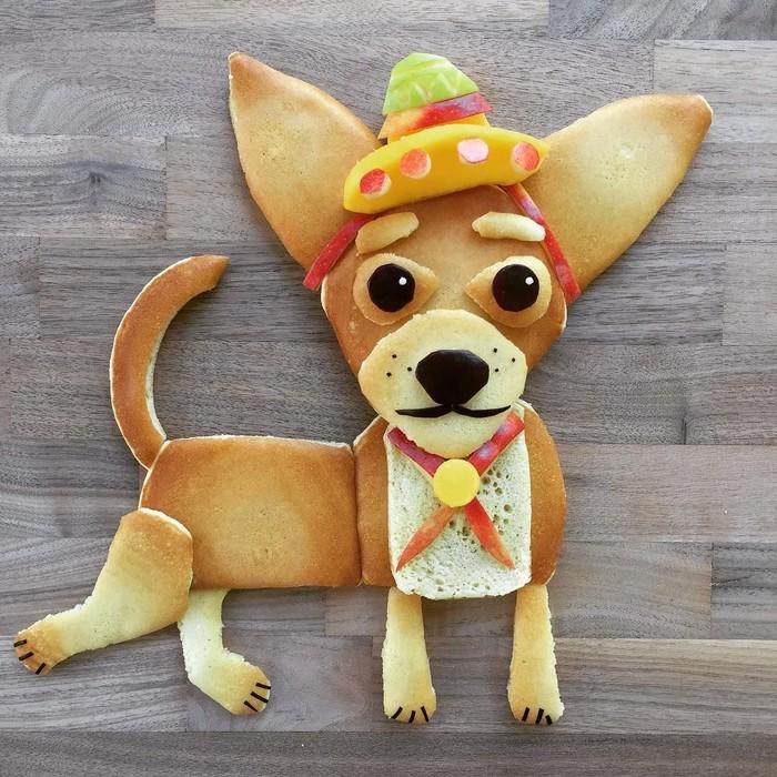 Anjing chihuahua ini dibuat dari pancake. Tak hanya polos, anjing pancake ini juga dibuat dengan hiasan tumpukan potongan buah dan roti. Foto: Instagram @foodartfun