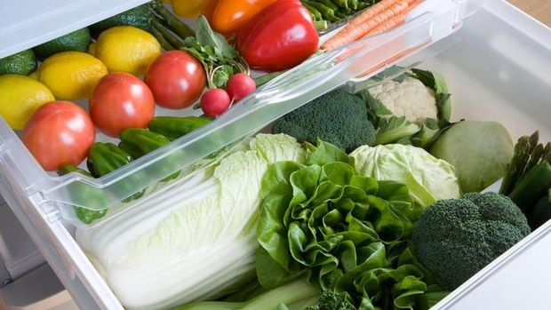 Fresh green vegetables in packing and with onion, potatoes, garlic and oranges, grocery shopping, daily needs