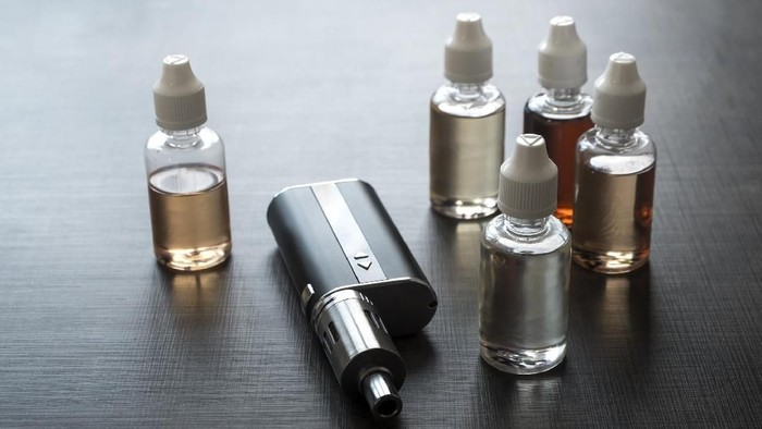 E-cigarettes with lots of different re-fill bottles, close up