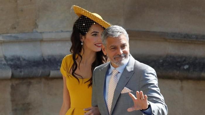 George Clooney dan Amal Clooney. Foto: Odd ANDERSEN/Pool via REUTERS