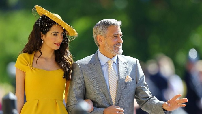 Amal Clooney and George Clooney arrive at St Georges Chapel at Windsor Castle for the wedding of Meghan Markle and Prince Harry.  Saturday May 19, 2018. Gareth Fuller/Pool via REUTERS