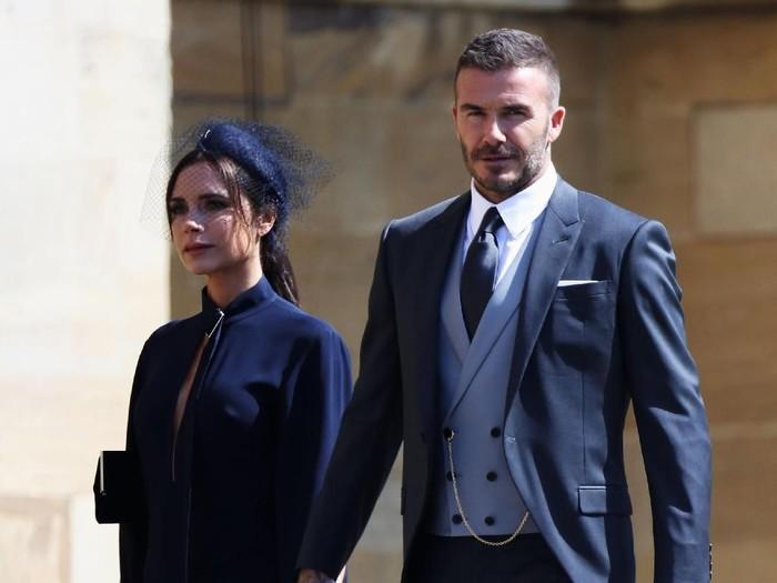 Victoria Beckham dan David Beckham di pernikahan Pangeran Harry dan Meghan Markle. Foto: Getty Images