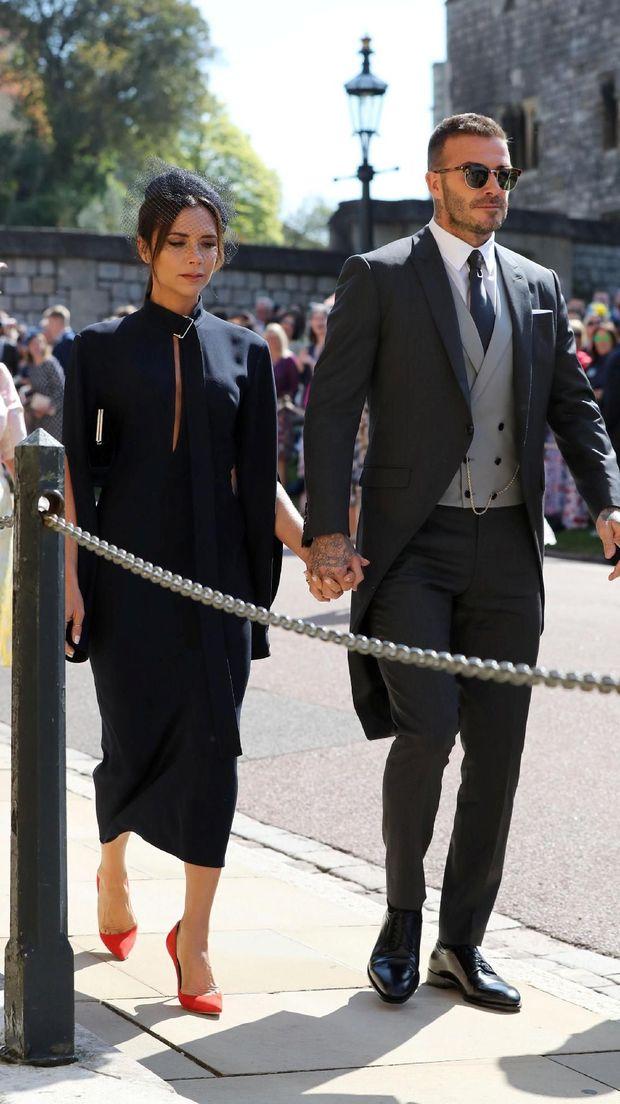 David dan Victoria Beckham saat menghadiri pernikahan Meghan Markle dan Pangeran Harry pada Mei lalu.
