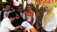 Taufik Madjid dan Irna Narulita mengumumkan pemenang lomba mewarnai. Istimewa/Jurnalis Mancing.