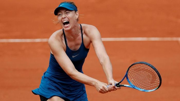 Maria Sharapova mengalahkan Richel Hogenkamp di babak pertama Prancis Terbuka 2018 (Foto: Gonzalo Fuentes/Reuters)