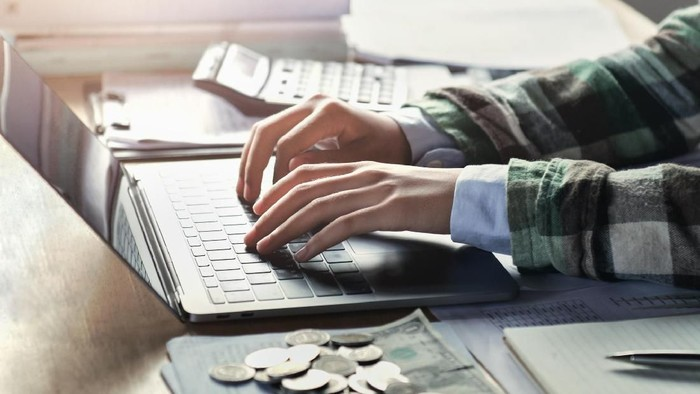 businesswoman working on desk with using laptop. concept finance and accounting