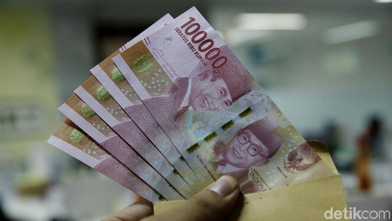 Foto: Ilustrasi uang THR (Muhammad Ridho/detikTravel)